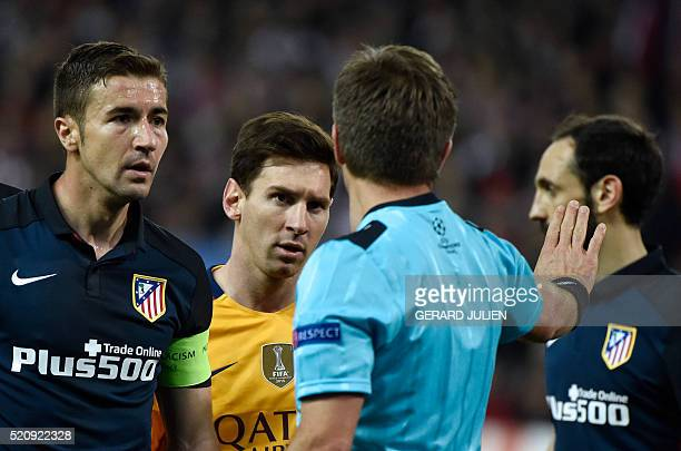 Atletico Madrid's midfielder Gabi and Barcelona's Argentinian forward Lionel Messi look at Italian referee Nicola Rizzoli during the Champions League...