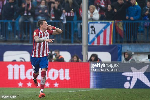 Atletico Madrid's midfielder Gabi celebrates after scoring during the Spanish league football match Club Atletico de Madrid vs SD Eibar at the...