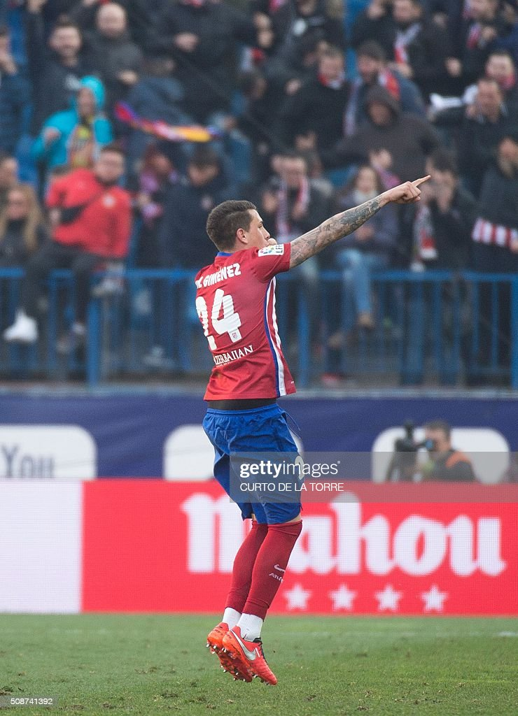Atletico Madrid's midfielder Gabi celebrates after scoring during the Spanish league football match Club Atletico de Madrid vs SD Eibar at the Vicente Calderon stadium in Madrid on February 6, 2016. AFP PHOTO / CURTO DE LA TORRE / AFP / CURTO DE LA TORRE