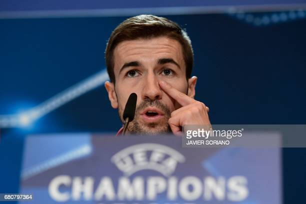 Atletico Madrid's midfielder Gabi gestures during a press conference at the Vicente Calderon stadium in Madrid on May 9 2017 on the eve of their UEFA...