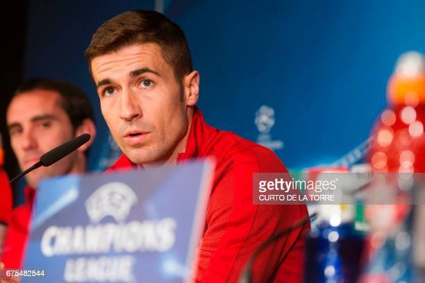 Atletico Madrid's midfielder Gabi looks on during a press conference at Santiago Bernabeu stadium in Madrid on May 1 2017 on the eve of their UEFA...
