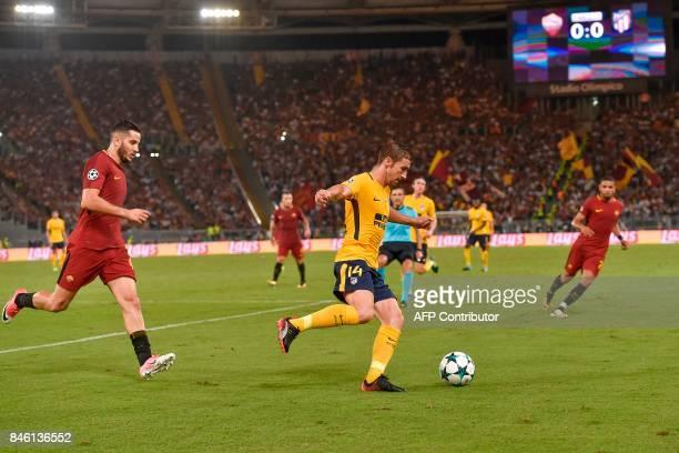 Atletico Madrid's midfielder Gabi outruns Roma's Greek defender Konstantinos Manolas during the UEFA Champions League Group C football match between...