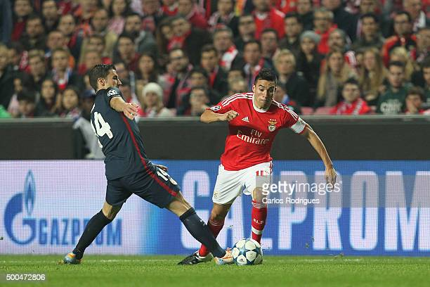 Atletico Madrid's midfielder Gabi vies with Benfica's midfielder Nicolas Gaitan during the match between SL Benfica and Club Atletico de Madrid for...