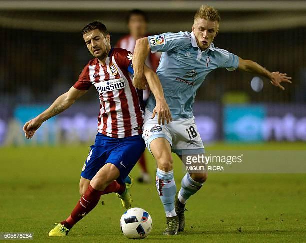 Atletico Madrid's midfielder Gabi vies with Celta Vigo's Danish defender Daniel Wass during the Spanish Copa del Rey football match Celta Vigo vs...