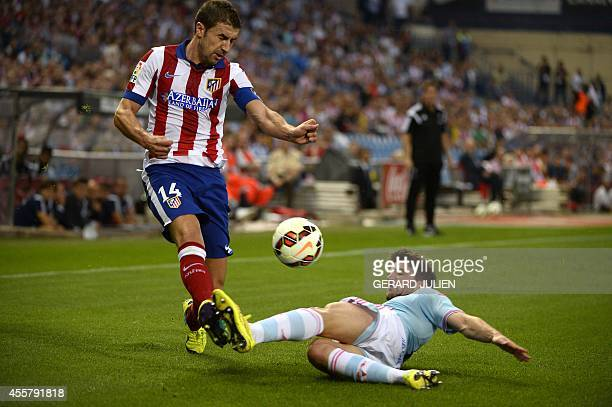 Atletico Madrid's midfielder Gabi vies with Celta Vigo's defender Carles Planas during the Spanish league football match Club Atletico de Madrid vs...