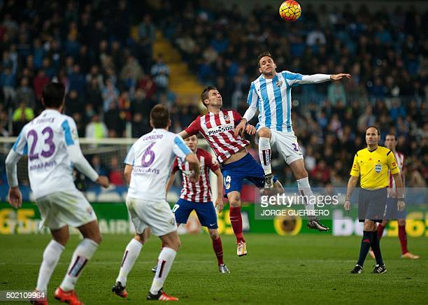 Atletico Madrid's midfielder Gabi vies with Malaga's Croatian forward Duje Cop during the Spanish league football match Malaga CF vs Club Atletico de...