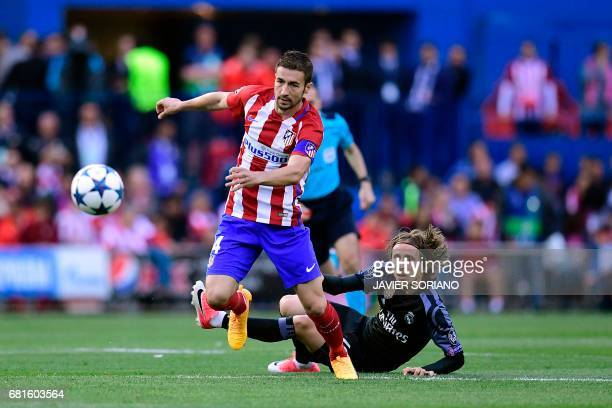 Atletico Madrid's midfielder Gabi vies with Real Madrid's Croatian midfielder Luka Modric during the UEFA Champions League semi final second leg...