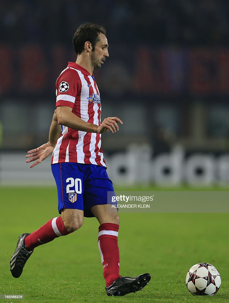 Atletico Madrid's midfielder Juanfran controls the ball during the UEFA Champions League Group G football match Austria Wien vs Atletico de Madrid in Vienna, Austria on October 22, 2013. AFP PHOTO / ALEXANDER KLEIN