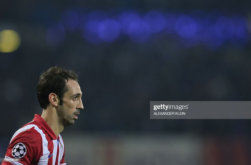 Atletico Madrid's midfielder Juanfran reacts during the UEFA Champions League Group G football match Austria Wien vs Atletico de Madrid in Vienna, Austria on October 22, 2013. AFP PHOTO / ALEXANDER KLEIN
