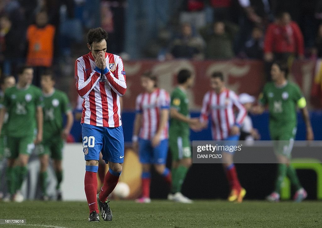 Atletico Madrid's midfielder Juanfran reacts during the UEFA Europa league round of 32 first leg football match Atletico de Madrid vs FC Rubin Kazan at the Vicente Calderon stadium in Madrid on February 14, 2013. Rubin Kazan won 2-0.