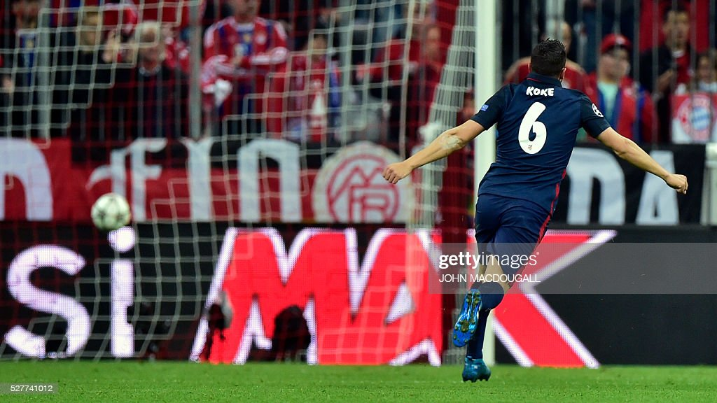 Atletico Madrid's midfielder Koke celebrates after his French teammate Antoine Griezmann scored during the UEFA Champions League semi-final, second-leg football match between FC Bayern Munich and Atletico Madrid in Munich, southern Germany, on May 3, 2016. / AFP / John MACDOUGALL