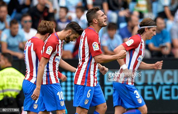Atletico Madrid's midfielder Koke celebrates after scoring a goal during the Spanish league football match RC Celta de Vigo vs Club Atletico de...