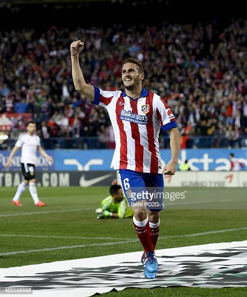 Atletico Madrid's midfielder Koke celebrates after scoring during the Spanish league football match Atletico Madrid vs Valencia CF at the Vicente...