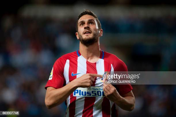 Atletico Madrid's midfielder Koke celebrates after scoring during the Spanish league football match Malaga CF vs Club Atletico de Madrid at La...
