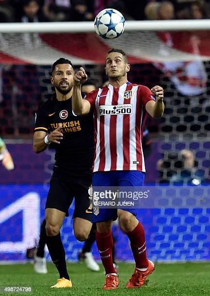 Atletico Madrid's midfielder Koke heads a ball next to Galatasaray's midfielder Yasin Oztekin during the UEFA Champions League Group C football match...