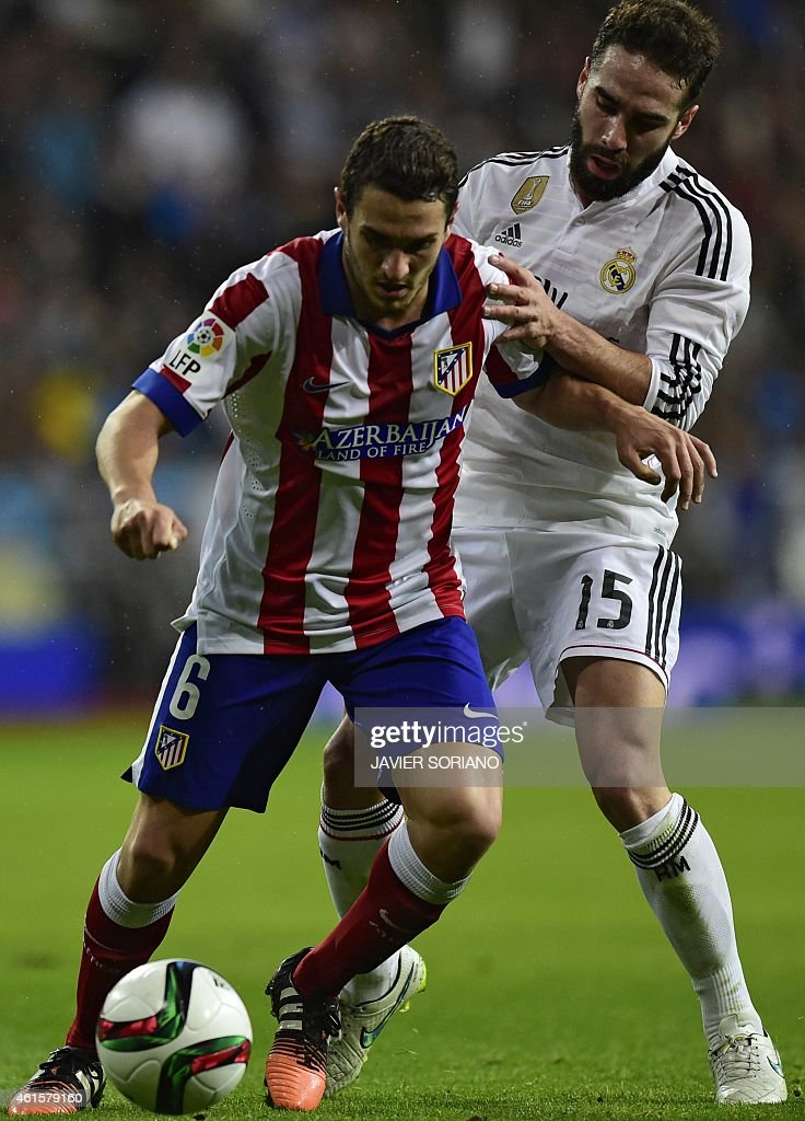Atletico Madrid's midfielder <a gi-track='captionPersonalityLinkClicked' href=/galleries/search?phrase=Koke+-+Soccer+Midfielder+-+Born+1992&family=editorial&specificpeople=11132098 ng-click='$event.stopPropagation()'>Koke</a> (L) vies with Real Madrid's defender <a gi-track='captionPersonalityLinkClicked' href=/galleries/search?phrase=Dani+Carvajal+-+Spanish+Soccer+Defender&family=editorial&specificpeople=7916431 ng-click='$event.stopPropagation()'>Dani Carvajal</a> during the Spanish Copa del Rey (King's Cup) round of 16 second leg football match Real Madrid CF vs Club Atletico de Madrid at the Santiago Bernabeu stadium in Madrid on January 15, 2015.