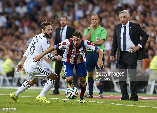 Atletico Madrid's midfielder Koke vies with Real Madrid's defender Daniel Carvajal during the Spanish Supercup firstleg football match Real Madrid CF...