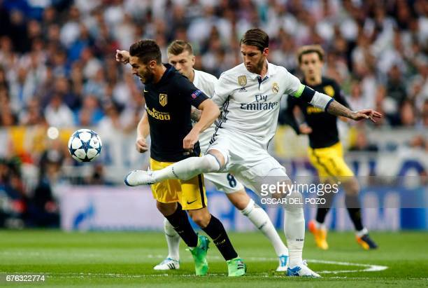 Atletico Madrid's midfielder Koke vies with Real Madrid's defender Sergio Ramos during the UEFA Champions League semifinal first leg football match...