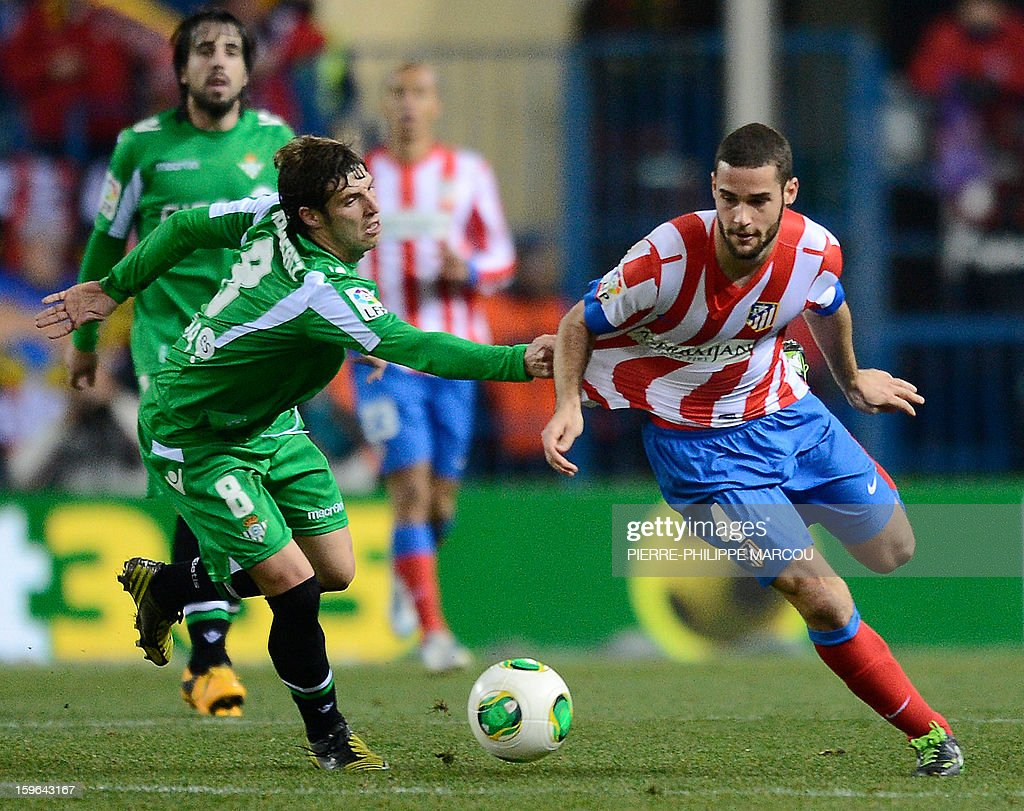 Atletico Madrid's midfielder Mario Suarez (R) vies with Betis' midfielder Ruben Perez during the Spanish Copa del Rey (King's Cup) quarter-final first leg football match Club Atletico de Madrid vs Real Betis at the Vicente Calderon stadium in Madrid on January 17, 2013.