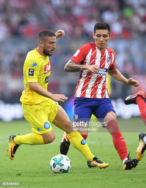 Atletico Madrid's midfielder Matias Kranevitter and Napoli's Belgian striker Dries Mertens vie for the ball during the first Audi Cup football match...