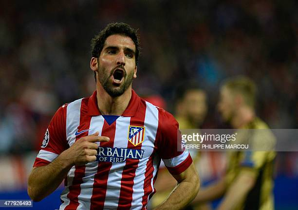 Atletico Madrid's midfielder Raul Garcia celebrates after scoring their third goal during the UEFA Champions League quarterfinal second leg football...
