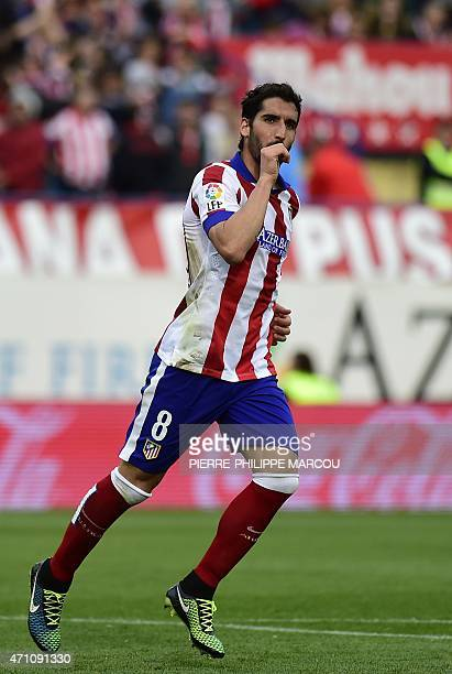Atletico Madrid's midfielder Raul Garcia celebrates after scoring during the Spanish league football match Club Atletico Madrid vs Elche FC at the...