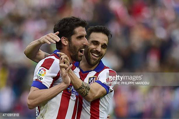 Atletico Madrid's midfielder Raul Garcia celebrates with Atletico Madrid's defender Jesus Gamez after scoring during the Spanish league football...
