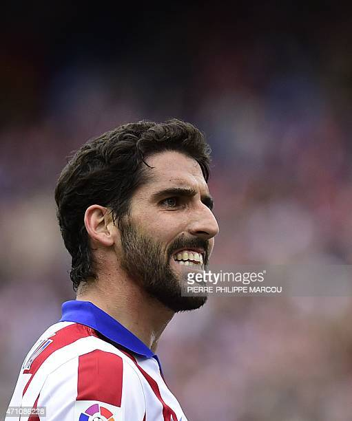 Atletico Madrid's midfielder Raul Garcia grimaces during the Spanish league football match Club Atletico Madrid vs Elche FC at the Vicente Calderon...