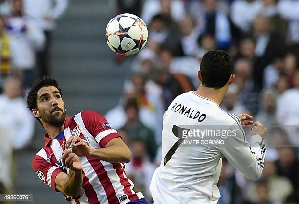 Atletico Madrid's midfielder Raul Garcia vies with Real Madrid's Portuguese forward Cristiano Ronaldo during the UEFA Champions League Final Real...