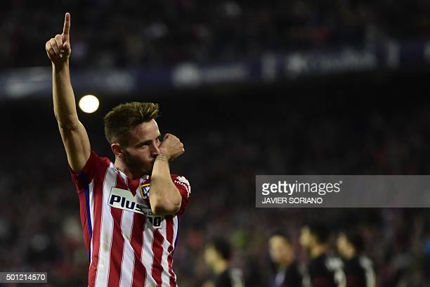 Atletico Madrid's midfielder Saul Niguez celebrates after scoring a goal during the Spanish league football match Club Atletico de Madrid vs Athletic...