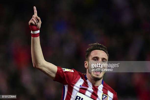 Atletico Madrid's midfielder Saul Niguez celebrates after scoring during the Spanish league football match Club Atletico de Madrid vs RC Deportivo La...