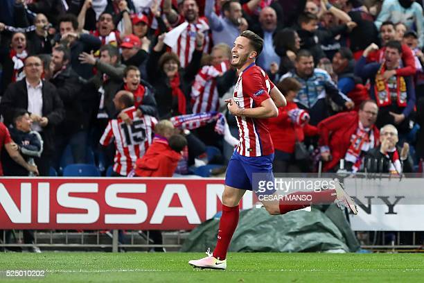 Atletico Madrid's midfielder Saul Niguez celebrates after scoring during the UEFA Champions League semifinal first leg football match Club Atletico...