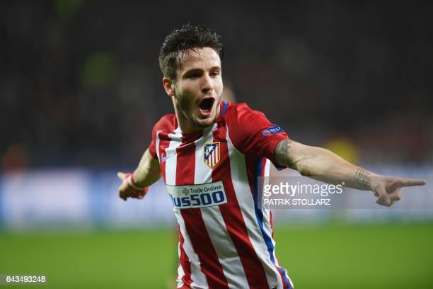 Atletico Madrid's midfielder Saul Niguez celebrates scoring the opening goal during the UEFA Champions League round of 16 firstleg football match...