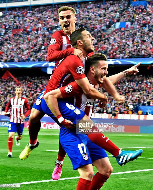 Atletico Madrid's midfielder Saul Niguez celebrates with teammates during the UEFA Champions League semifinal first leg football match Club Atletico...