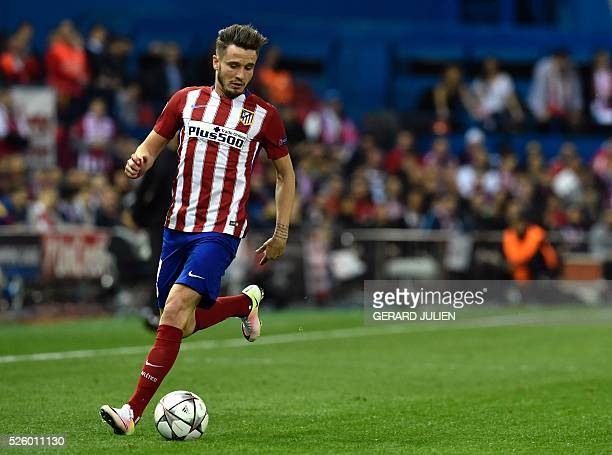 Atletico Madrid's midfielder Saul Niguez controls a ball during the UEFA Champions League semifinal first leg football match Club Atletico de Madrid...