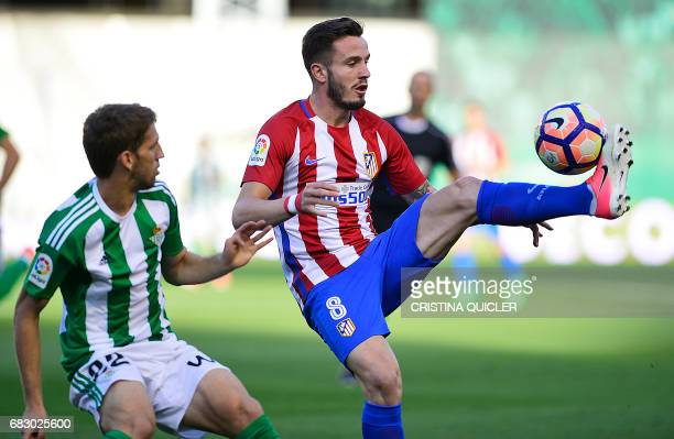 Atletico Madrid's midfielder Saul Niguez controls the ball past Betis' Serbian midfielder Darko Brasanac during the Spanish league football match...