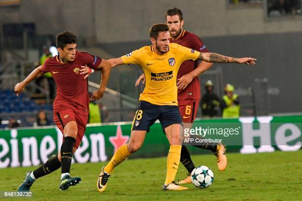 Atletico Madrid's midfielder Saul Niguez holds off Roma's Argentinian forward Diego Perotti during the UEFA Champions League Group C football match...