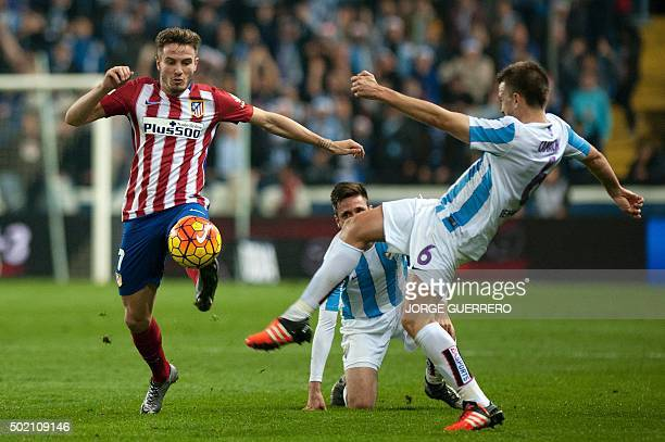 Atletico Madrid's midfielder Saul Niguez vies with Malaga's midfielder Ignacio Camacho during the Spanish league football match Malaga CF vs Club...