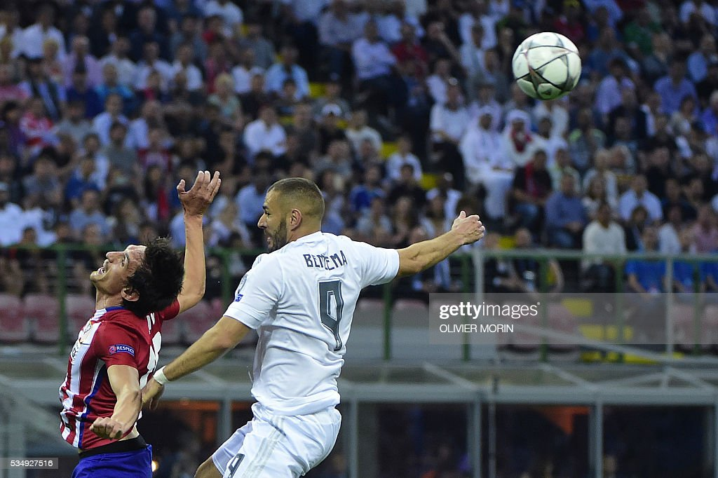 Atletico Madrid's Montenegrin defender Stefan Savic (L) and Real Madrid's French forward Karim Benzema fight for the ball during the UEFA Champions League final football match between Real Madrid and Atletico Madrid at San Siro Stadium in Milan, on May 28, 2016. / AFP / OLIVIER