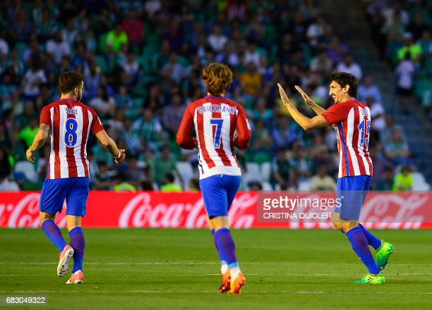 Atletico Madrid's Montenegrin defender Stefan Savic celebrates a goal during the Spanish league football match Real Betis vs Club Atletico de Madrid...