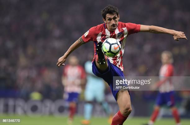 Atletico Madrid's Montenegrin defender Stefan Savic controls the ball during the Spanish league football match Club Atletico de Madrid vs FC...