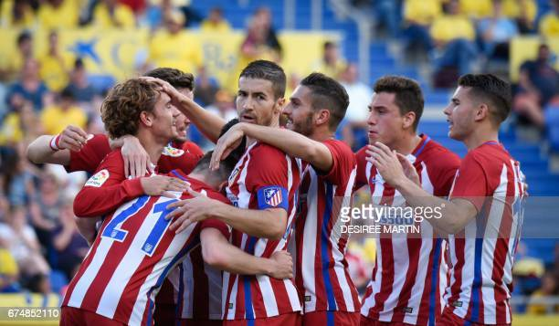 TOPSHOT Atletico Madrid's players celebrate a goal during the Spanish league football match UD Las Palmas vs Club Atletico de Madrid at the Gran...