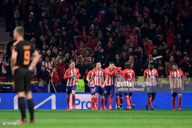 Atletico Madrid's players celebrate their second goal during the UEFA Champions League group C football match between Atletico Madrid and AS Roma at...