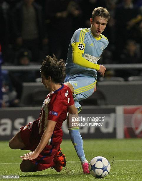 Atletico Madrid's Portuguese midfielder Tiago vies with Astana's Kazakh forward Baurzhan Dzholchiev during the UEFA Champions League group C football...