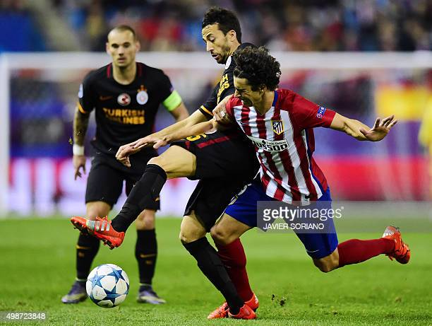 Atletico Madrid's Portuguese midfielder Tiago vies with Galatasaray's midfielder Bilal Kisa during the UEFA Champions League Group C football match...