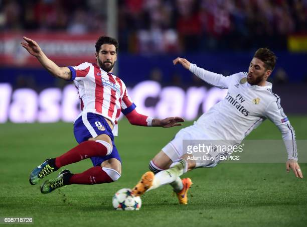 Atletico Madrid's Raul Garcia and Real Madrid's Sergio Ramos compete for the ball