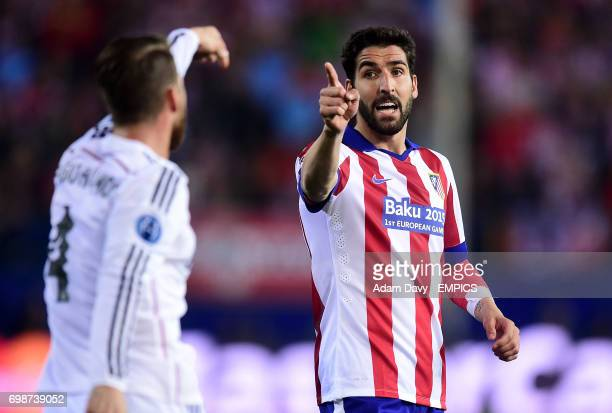 Atletico Madrid's Raul Garcia argues with Real Madrid's Sergio Ramos