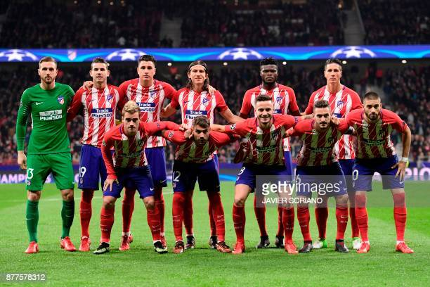 Atletico Madrid's Slovenian goalkeeper Jan Oblak Atletico Madrid's French defender Lucas Hernandez Atletico Madrid's Uruguayan defender Jose Gimenez...