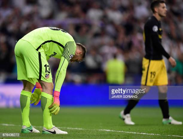 Atletico Madrid's Slovenian goalkeeper Jan Oblak bends on the field at the end of the UEFA Champions League semifinal first leg football match Real...