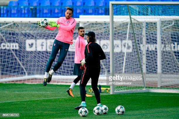 Atletico Madrid's Slovenian goalkeeper Jan Oblak catches a ball during a training session at the Vicente Calderon Stadium in Madrid on October 30...